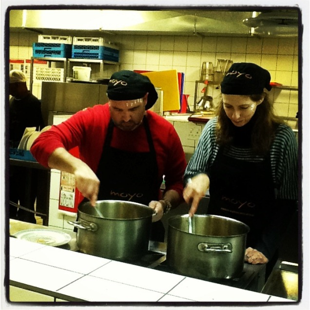 Dax and Joanne stirring pots