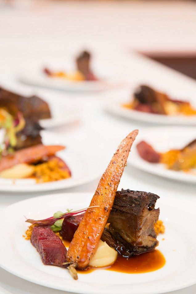 Braised beef short rib and pickled tongue served with parsnip purée, rainbow carrot and spiced nut crumb.