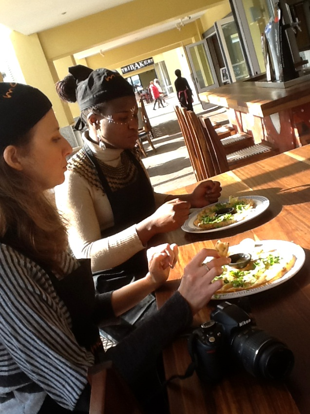 "Joanne and Thuli tasting their rather ""crispy"" flatbreads"