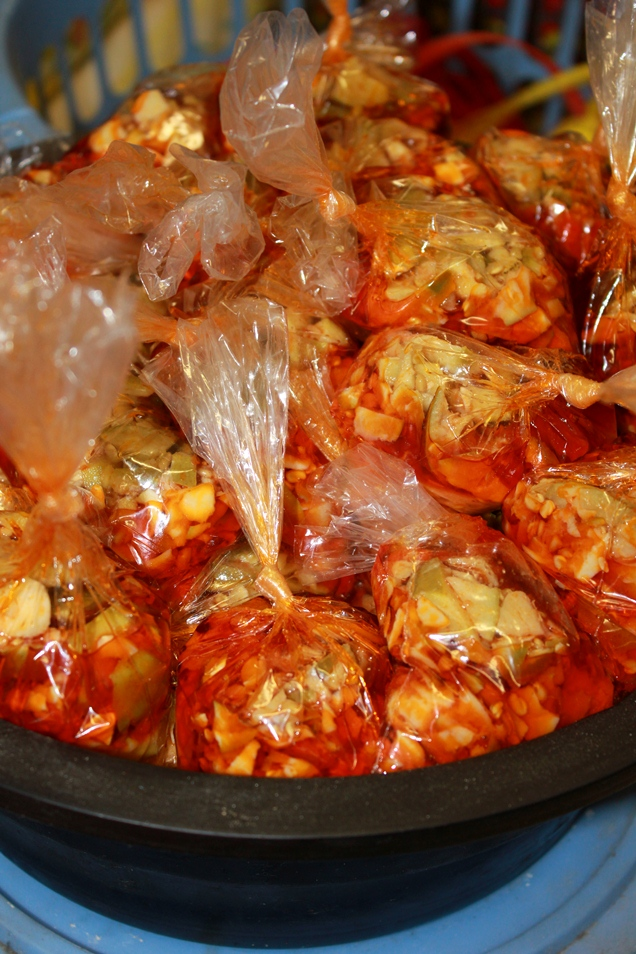Atchar in tied up plastic bags...the demand must be fierce!